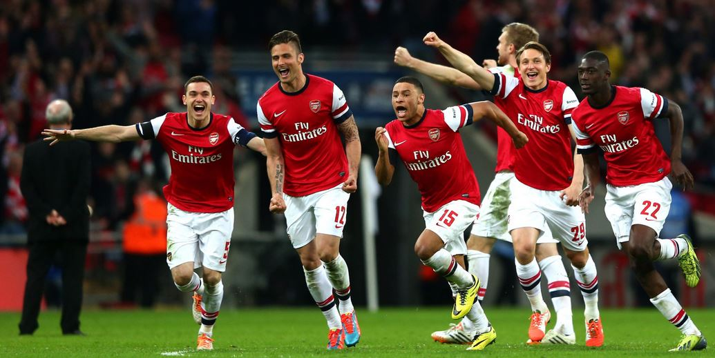 Arsenal players celebrating their overpowering game