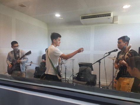 Nayomaze rehearsing in the recording studio.